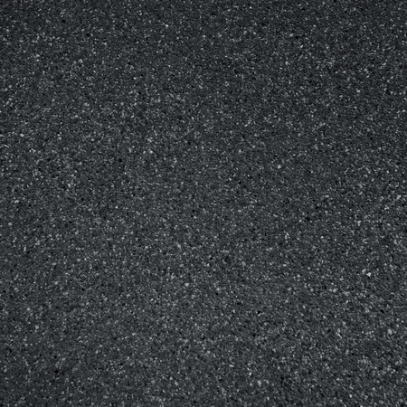rough road: dark grey asphalt pavement texture with small rocks