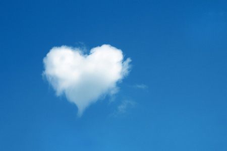 heart shaped cloud in the blue sky Stock Photo