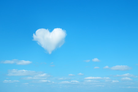 shaped: heart shaped cloud in the blue sky Stock Photo