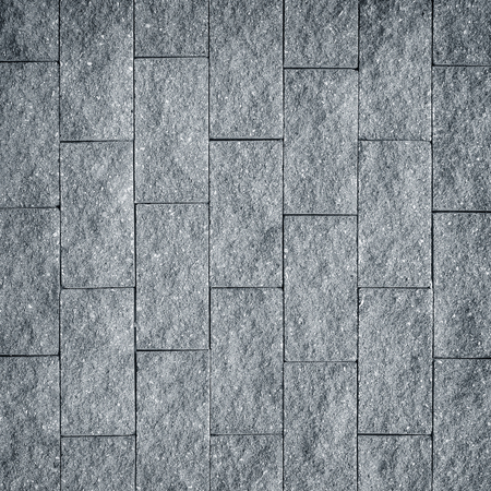 sombre: gray cement brick wall background Stock Photo