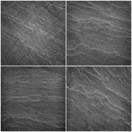 Dark grey / black slate background or texture.