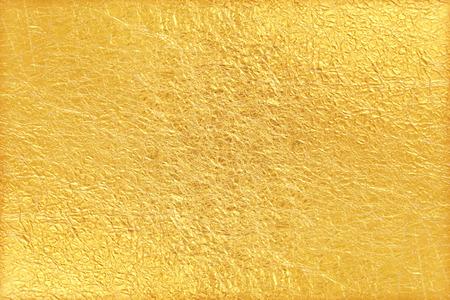Błyszczące żółty liść tło tekstury folii złota
