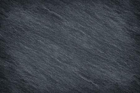 Dunkelgrauer schwarzer Schiefer Hintergrund oder Textur Standard-Bild