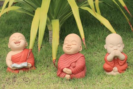 ornamental garden: Doll clay monk used in ornamental garden in temple of Thailand