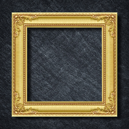 baroque picture frame: gold frame on Dark grey black slate background or texture.