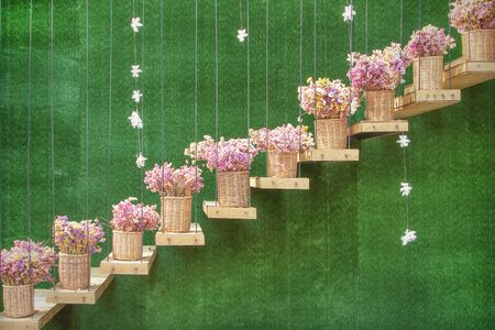wall decoration: colorful flowers pots on decoration stair whit  artificial grass backbackground