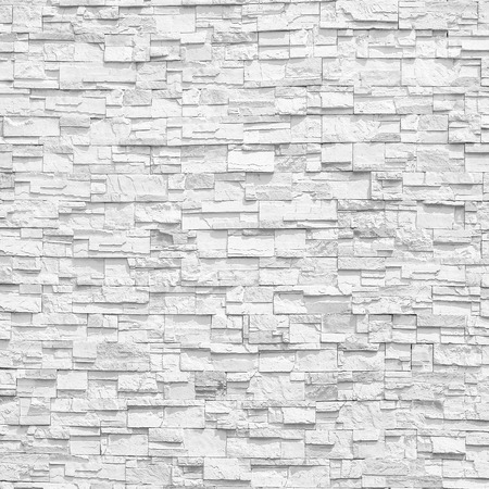 decorative wall: Surface white wall of stone wall gray tones for use as background. The new design of modern stone wall. pattern of decorative stone wall surface.