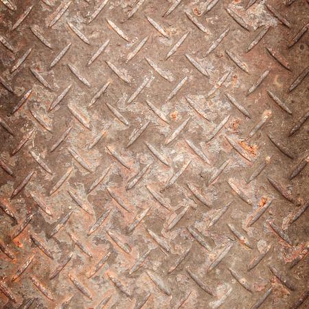 diamond plate background: Rusty metal diamond plate background