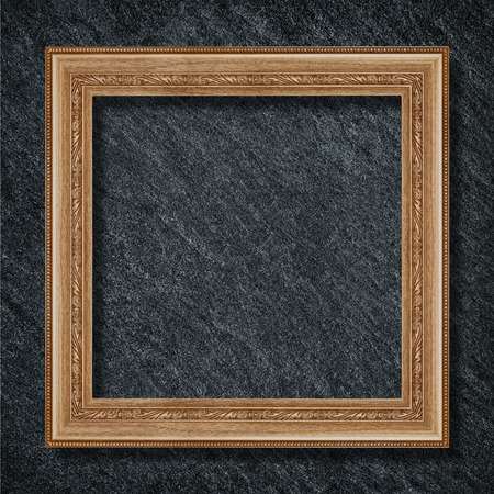 Vintage wooden frame isolated on black slate stone background Stock Photo