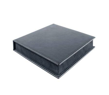 unexpectedness: black leather box on white background Stock Photo