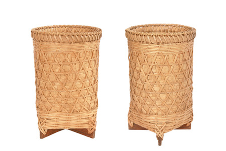 homeware: basket made from wicker and bamboo isolated on white background.