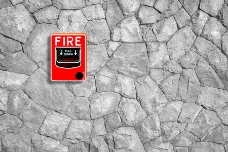escape key: fire break glass on the stone wall background Stock Photo