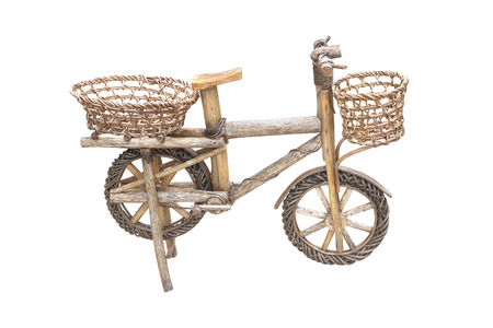 rickety: old wooden and rattan  bicycle toy isolated on white