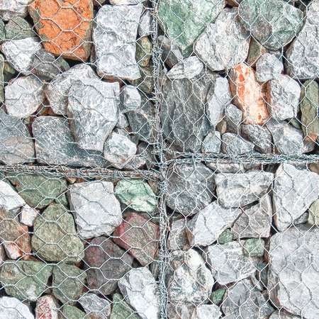 gabion mesh: stones in metal mesh to strengthen the banks of the river