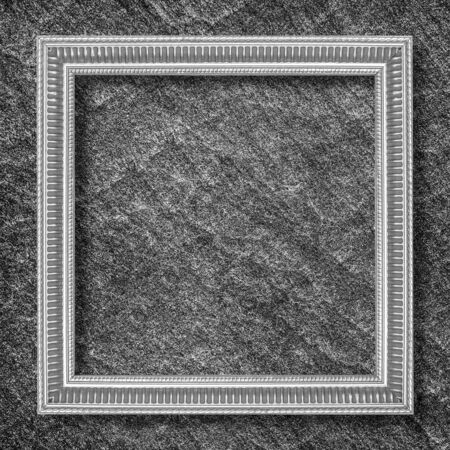silver frame: silver frame on black slate background Stock Photo