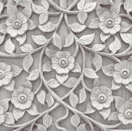 gray wooden Pattern of flower carved on wood background