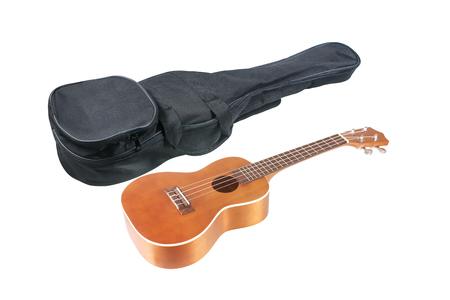 Ukulele with ukulele bag case isolated on white