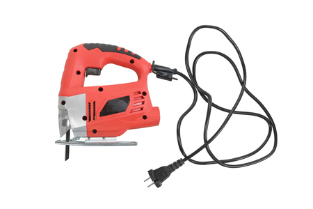 Electric jig saw with electric wire and plug isolated on white