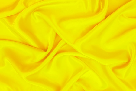 abstract background yellow luxury cloth or wavy folds of grunge silk texture material Standard-Bild