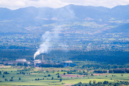 factory with smoke in the field and nature environmental pollution