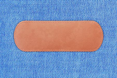 close up label leather on blue Denim or blue Jeans background
