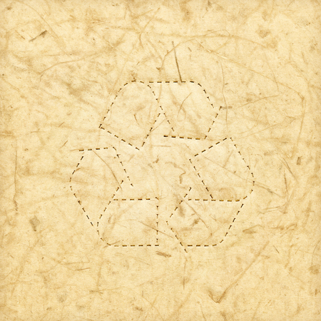 Recycled paper texture background with perforate recycle symbol for reuse