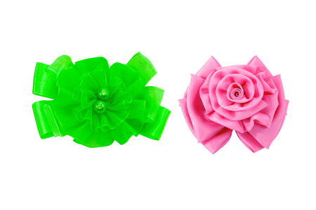 Green and pink satin fabric flower isolated onwhite background with clipping parh 版權商用圖片