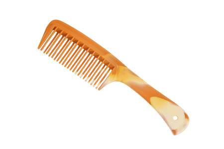 brown plastic comb isolated on white with clipping path