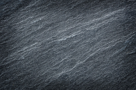 Dark grey black slate stone abstract background or texture. Stock Photo
