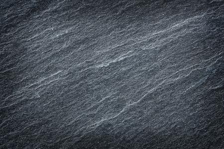 Dunkelgrauer schwarzer Schieferstein abstrakter Hintergrund oder Textur. Standard-Bild