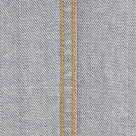 Grauer Denim- oder Jeansstoff mit abstraktem Hintergrund der Nahtstruktur