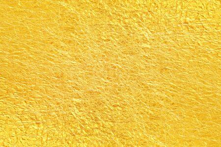 Glänzender gelber Blattgoldfolien-Beschaffenheitshintergrund Standard-Bild