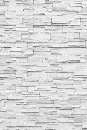 Parete bianca di superficie dei toni grigi del muro di pietra da utilizzare come sfondo.