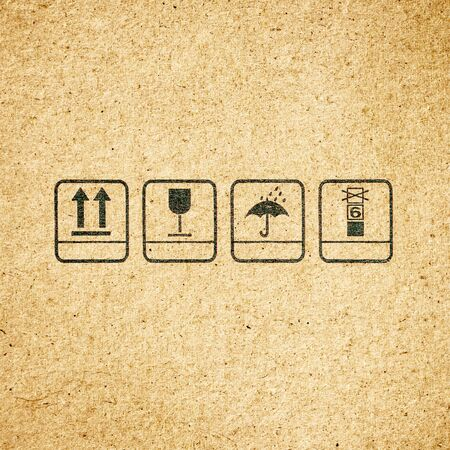 Standard signs or symbol on cardboard paper texture background