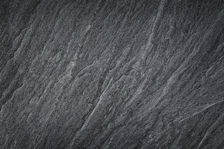 Dark grey black slate stone background or texture. 版權商用圖片