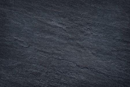 Dark grey black slate stone background or texture Stockfoto