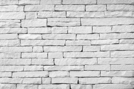 Surface white wall of stone wall gray tones for use as background.