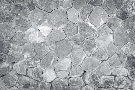 natural gray stone or rubble wall textured background