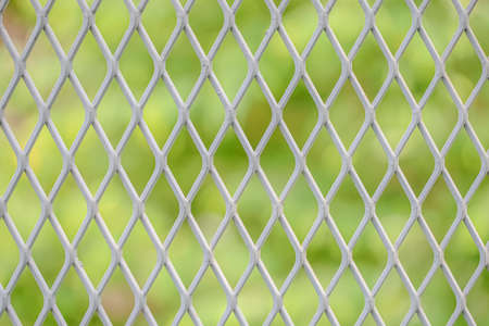 Grating net with nature green blur background