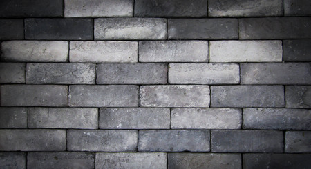 antique furniture: grung black brick wall On the street.can be used as background