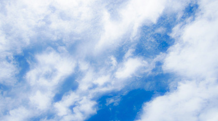 Blue background with clouds, very bright, beautiful, is the most beautiful sky. Can be used as a background.