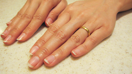 natural hands female with wedding ring