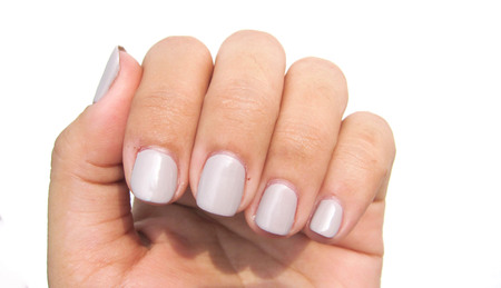 the nails is manicure. painted gray color.
