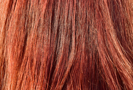 Asian women make red hair from chemicals to conceal gray hair and make it beautiful. can be use as background.