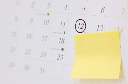 office calendar with appointment mark and blank postit note paper