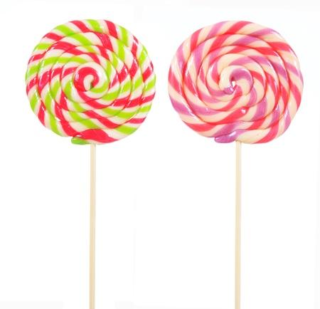 retro style colorful round shape lollipop on white background  版權商用圖片