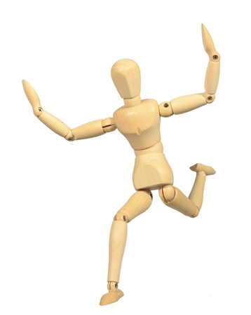 Yellow wooden dummy in run action isolated on white background