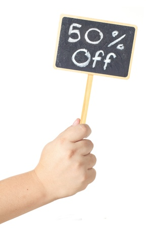 Hand raising a blackboard 50 percent sale  isolated on white background photo