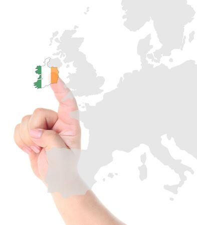 Finger touch on Italy map flag photo
