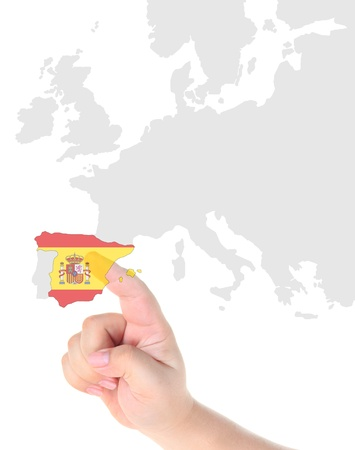 Finger touch on Spain map flag photo